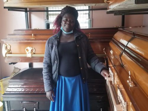 Afline Anyango at her coffin workshop in Nairobi. She says she no longer fears working in the environment as before.