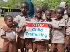 The photo is of young children who through civic education and fear of child trafficking, held peaceful demonstrations to call for immediate action on the criminal act of child trafficking.