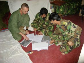 Major Jonathan Bossie of the United States Marine Corps, planning with members of the Afghan National Army.
