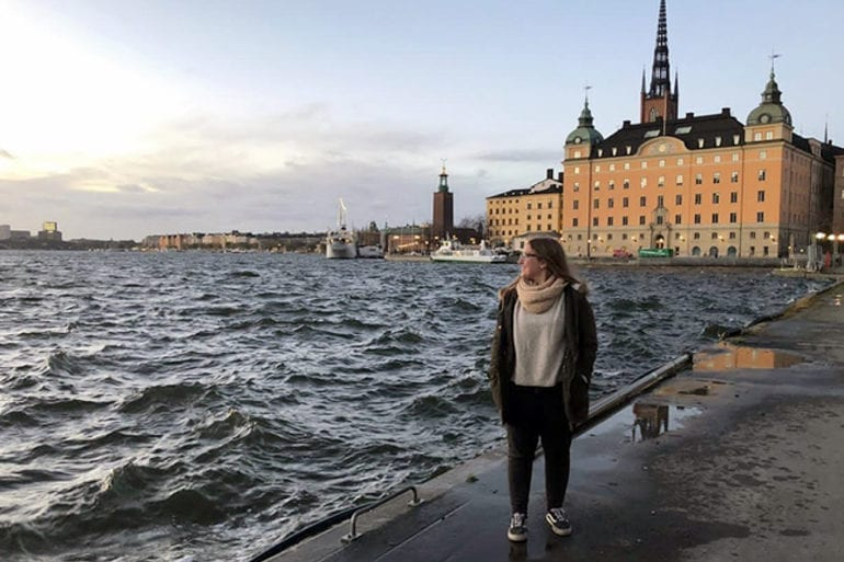 Camila Hernández stands at the waterfront in Sweden.