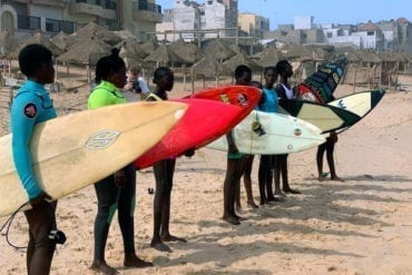 A photo showing surfers from the program participating in a training camp in Senegal.